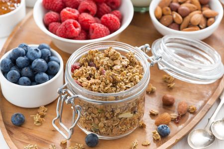 Photo for glass jar with homemade granola and berries, top view - Royalty Free Image