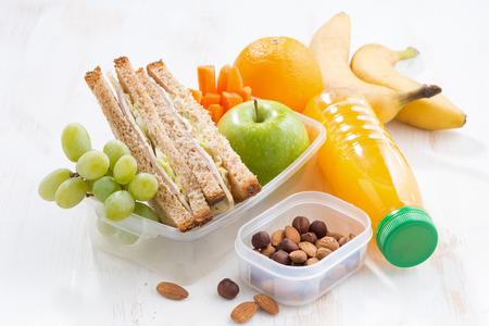 Photo pour school lunch with sandwich on white table, close-up - image libre de droit