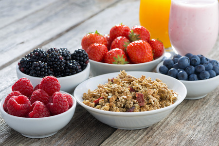 Photo for healthy breakfast with berries on wooden background, close-up, horizontal - Royalty Free Image