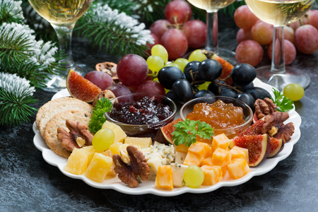 Photo for appetizers to the holiday - cheeses, fruits and jams, horizontal - Royalty Free Image