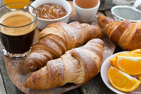 Photo for breakfast with fresh croissants on wooden table, close-up - Royalty Free Image
