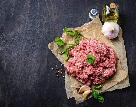 Foto de Raw minced meat with olive oil and garlic. Selective focus - Imagen libre de derechos