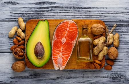 Foto de Healthy fat salmon, avocado, oil, nuts. Selective focus - Imagen libre de derechos
