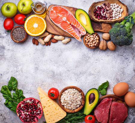 Photo pour Healthy food and superfood background. Meat, fish, legumes, nuts, seeds, greens, oil and vegetables Top view copy space - image libre de droit