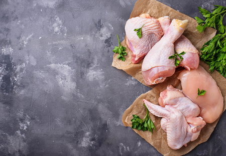 Foto de Raw chicken meat fillet, thigh, wings and legs - Imagen libre de derechos