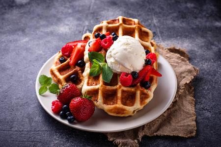 Foto de Belgium waffles with berries and ice cream. Selective focus - Imagen libre de derechos