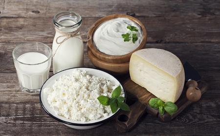 Foto de Dairy products on wooden background - Imagen libre de derechos