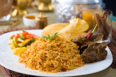 Biryani basmati mutton rice with traditional items on background