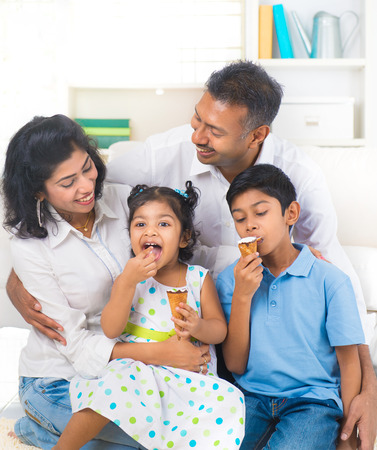 Photo for indian family enjoying eating ice cream indoor - Royalty Free Image