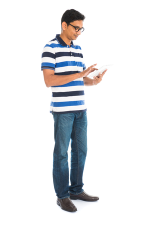 Photo for Happy young man using digital tablet against white background. - Royalty Free Image