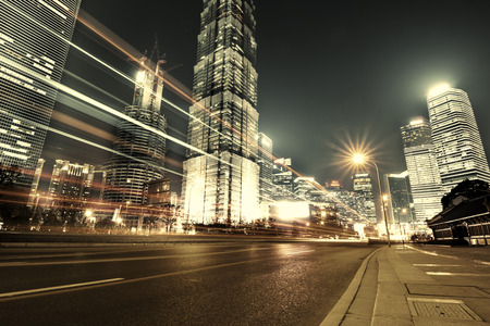 Foto de Shanghai Lujiazui Finance and Trade Zone of the modern city night background - Imagen libre de derechos