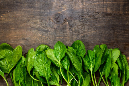 Foto per fresh green spinach on vintage wooden texture,top view - Immagine Royalty Free