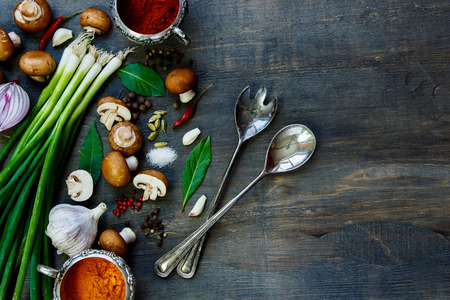 Photo pour Top view of fresh mushrooms with vegetables and spices on dark wooden table. Background with space for text. Vegetarian food, health or cooking concept. - image libre de droit