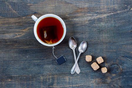 Photo for Top view of cup of tea on vintage wooden background. - Royalty Free Image