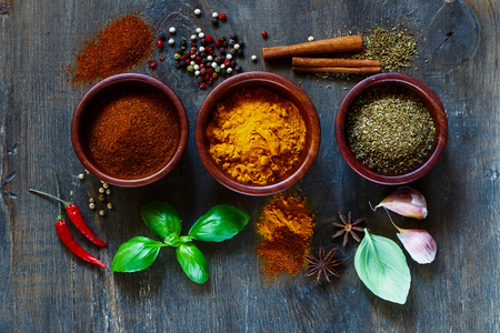 Photo for Assorted spices and herbs over dark old wood. Food and cuisine ingredients. Cooking background. - Royalty Free Image