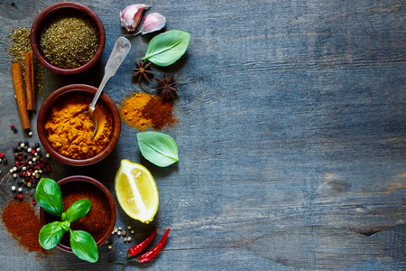 Photo for Various kind of spices and herbs over dark old wood. Food and cuisine ingredients. Background with space for text. - Royalty Free Image
