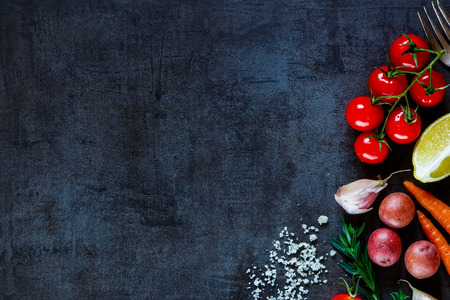 Photo for Close up of colorful spices and fresh vegetables for cooking on dark metal background with space for text. Top view. Bio Healthy food ingredients. - Royalty Free Image