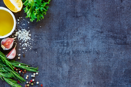Foto de Delicious ingredients and seasoning for healthy vegetarian cooking on dark vintage background. Top view. Copy space. - Imagen libre de derechos