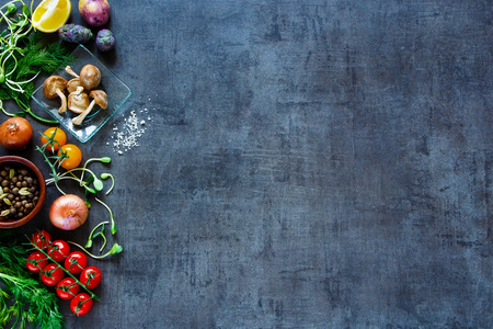 Raw organic vegetables with fresh ingredients for healthily cooking on vintage background, top view, banner.