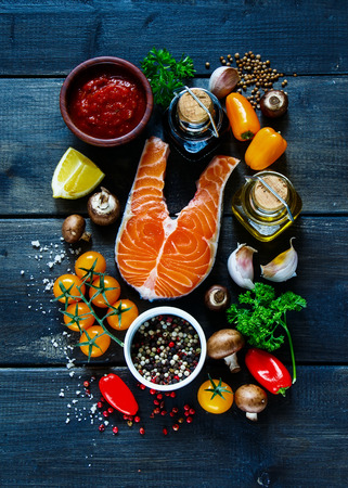 Photo for Raw steak of salmon with fresh ingredients for tasty cooking on rustic wooden background, top view, banner. - Royalty Free Image