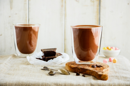 Photo for Composition with hot chocolate on light background. Warming sweet drink - Royalty Free Image