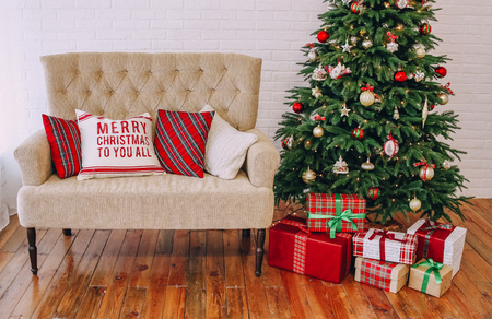 Photo pour New Year decorations style tartan red gold with a Christmas tree and a sofa - image libre de droit