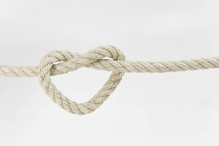 Photo pour leash  rope into heart shape on white background - image libre de droit