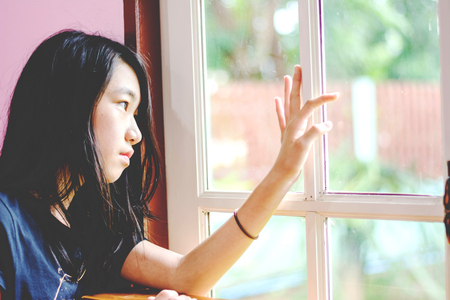Foto de depress and hopeless girl with absent minded looking outside - Imagen libre de derechos