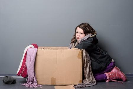 Foto de Upset girl leaning over box - Imagen libre de derechos