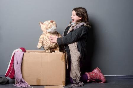 Foto de Enthusiastic girl playing with toy - Imagen libre de derechos