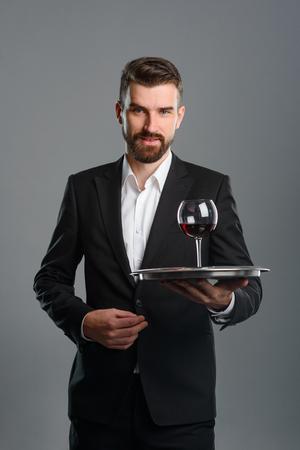 Foto de Sommelier holding tray with wineglass - Imagen libre de derechos