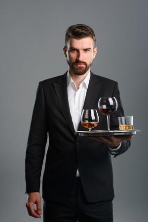 Foto de Waiter carrying tray with drinks - Imagen libre de derechos