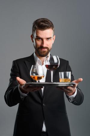 Foto de Waiter serving for tasting session - Imagen libre de derechos