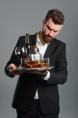 Foto de Tired waiter holding full tray - Imagen libre de derechos