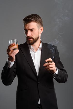 Foto de Rich man with drink and tobacco - Imagen libre de derechos