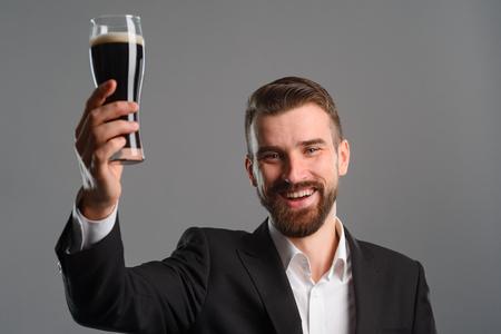 Foto de Man raised his glass - Imagen libre de derechos