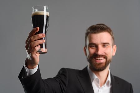 Foto de Beer glass in mans arms - Imagen libre de derechos