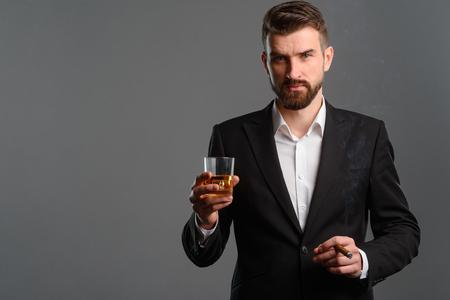 Photo pour Gentleman having drink and cigar - image libre de droit