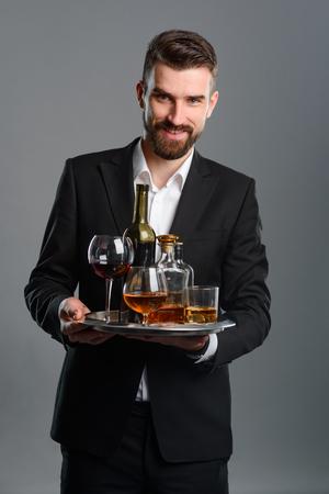 Foto de Sommelier carrying tray with beverages - Imagen libre de derechos