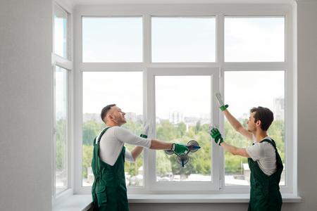 Foto de Two window installers - Imagen libre de derechos