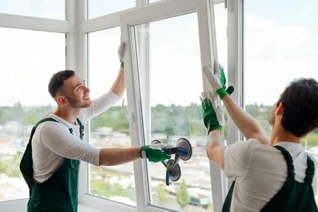 Photo pour Workers installing a window - image libre de droit