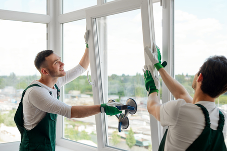 Foto de Workers installing a window - Imagen libre de derechos