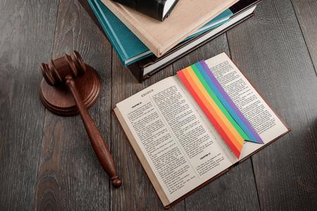 Foto de Judge's gavel and Exodus book of Bible with a rainbow bookmark. Ten commandments and LGBT marriage legalisation. - Imagen libre de derechos