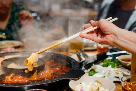 Photo for Cooking cartilage in hot pot - Royalty Free Image