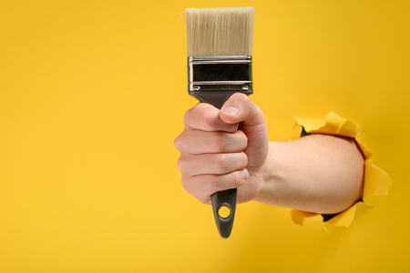 Photo for Hand holding a paint brush - Royalty Free Image