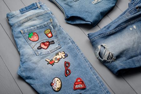 Photo pour Jeans with various patches - image libre de droit
