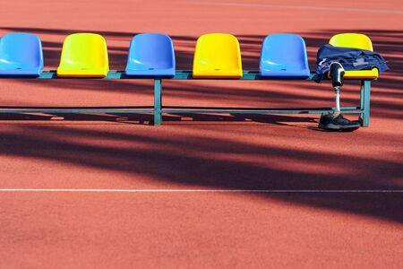 Photo pour Row of colorful plastic seats. Sports and disabilities. - image libre de droit