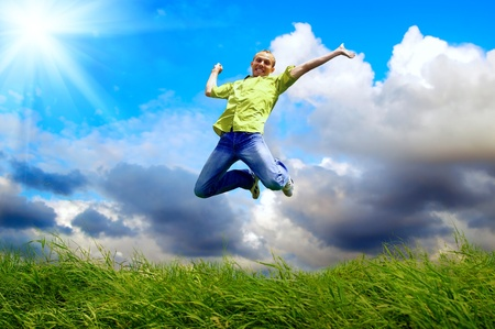 Photo for Fun man in jump on the outdoor background - Royalty Free Image