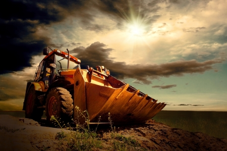 Foto de Yellow tractor on sky background - Imagen libre de derechos
