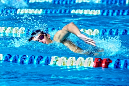 Swimmer in waterpool swim one of swimming style